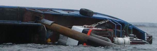 Capsized fishing dredger floats again